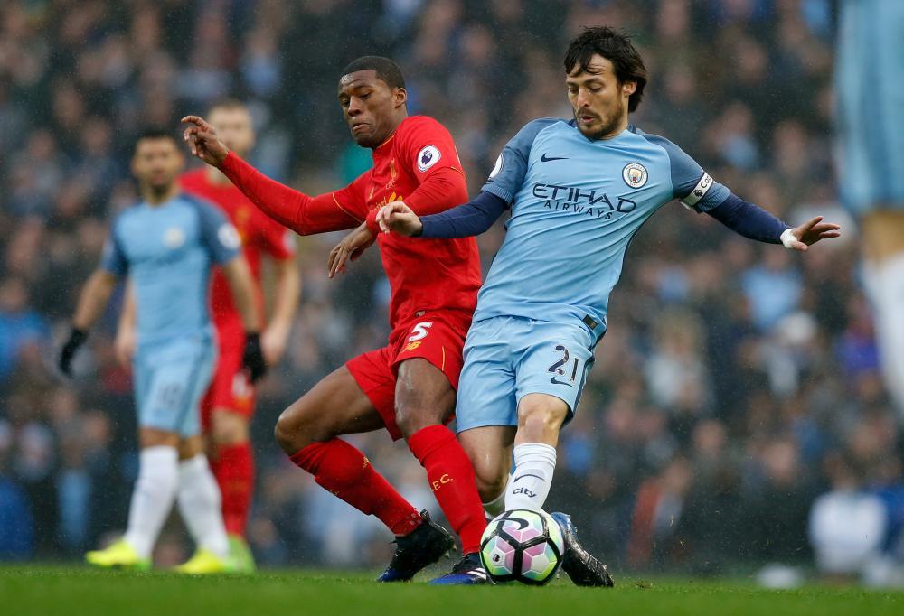Manchester City's David Silva in action with Liverpool's Georginio Wijnaldum