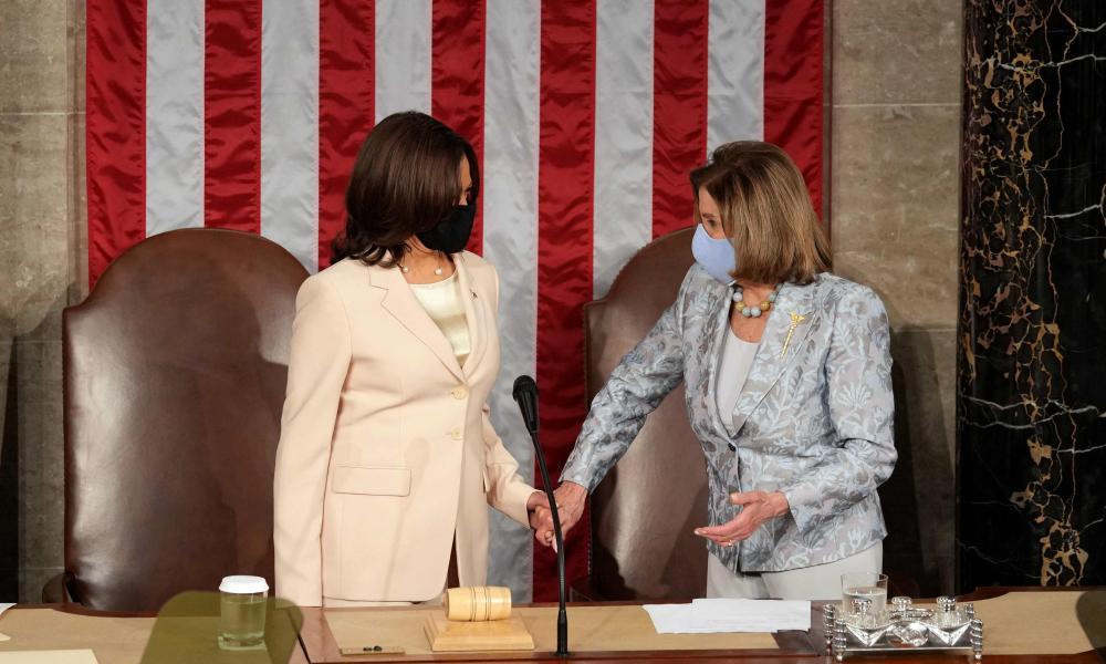 Kamala Harris and Nancy Pelosi take their positions.
