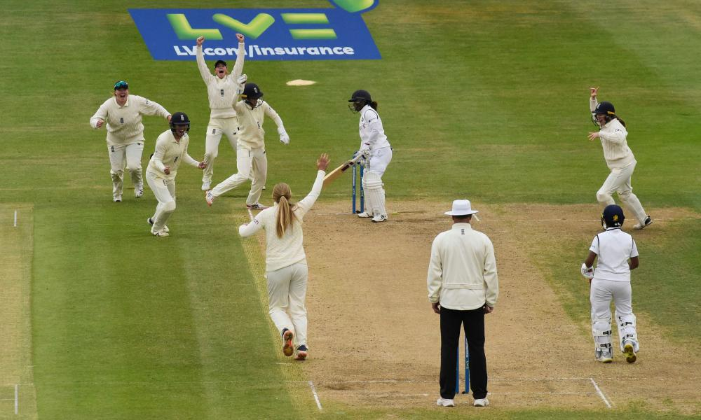 England's Sophie Ecclestone celebrates taking the wicket of India's Mithali Raj with teammates.