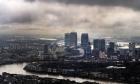 Dark clouds above London's financial heart, Canary Wharf, in London, Britain.