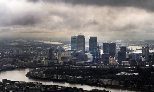 Dark clouds above London's financial heart, Canary Wharf, in London, Britain.