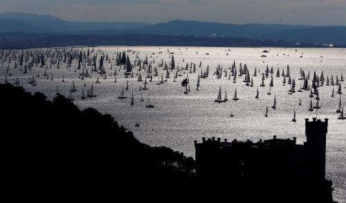 Sailing boats gather at the start of the Barcolana regatta in the Gulf of Trieste