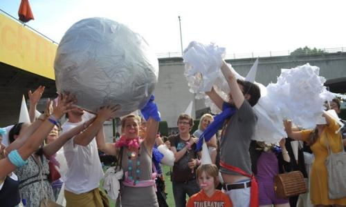 Residents play Pass the Impossibly Large Parcel on the South Bank, London in 2010.
