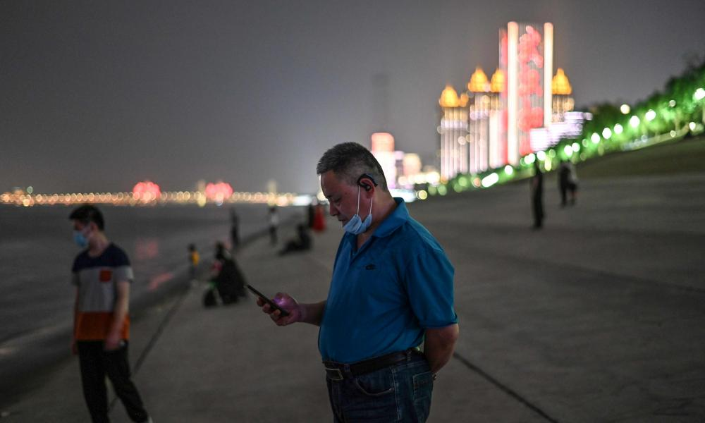 People wearing facemasks are seen along the shores of the Yangtze River in Wuhan, in Chinas central Hubei province on 13 May 2020.