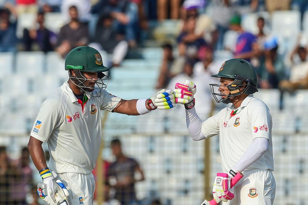 Mushfiqur Rahim (R) celebrates with Sabbir Rahman (L) during their momentum changing partnership.
