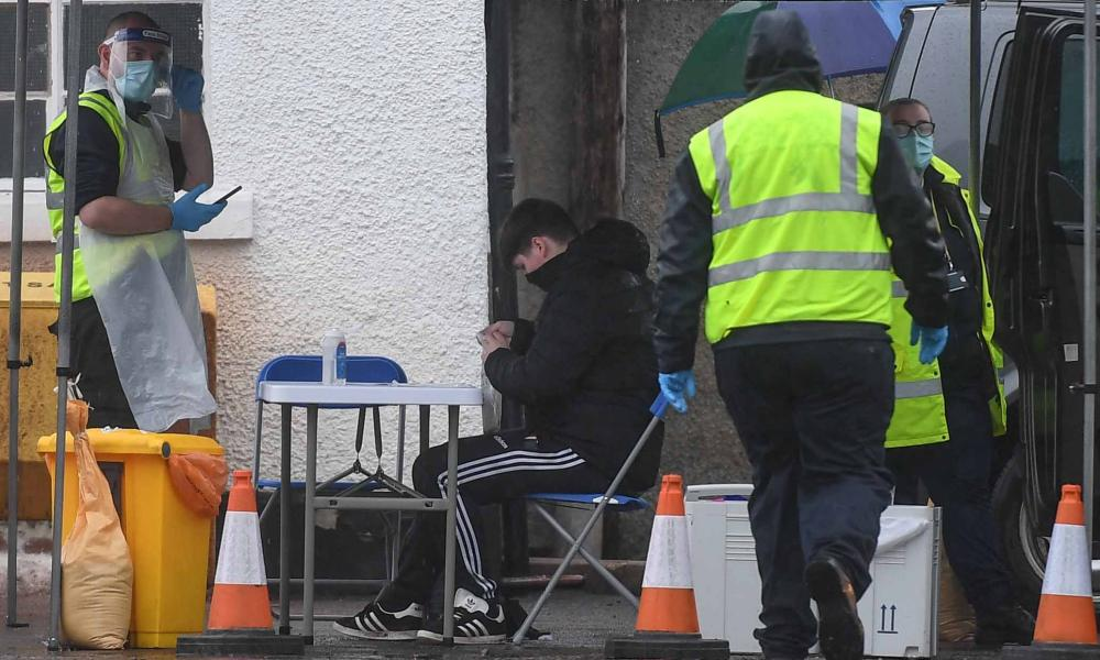 Workers are seen at a mobile covid testing site on in Grantown-On-Spey, Scotland.