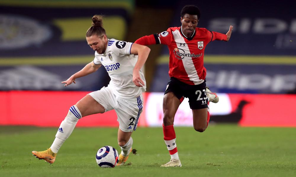 Leeds United's Luke Ayling (left) and Southampton's Nathan Tella battle for the ball.