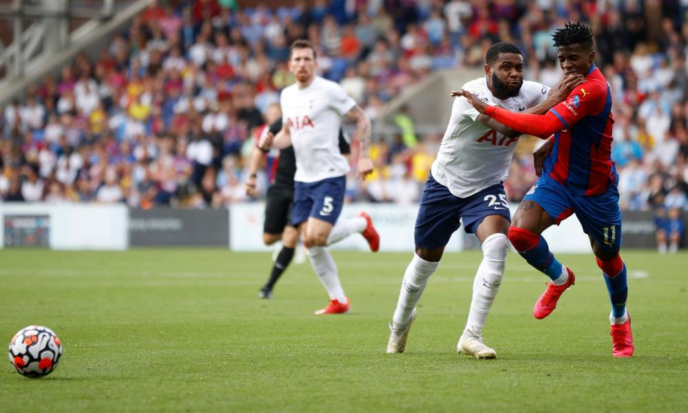 Tottenham Hotspur's Japhet Tanganga barges into Crystal Palace's Wilfried Zaha.