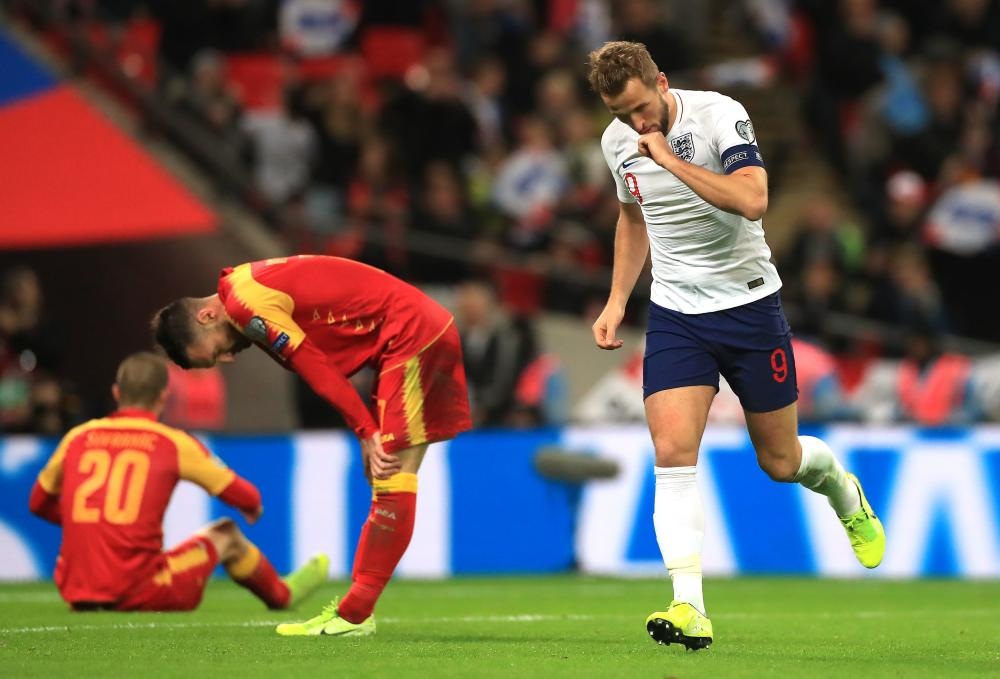 England's Harry Kane celebrates scoring his side's fifth goal of the game and his hat-trick.
