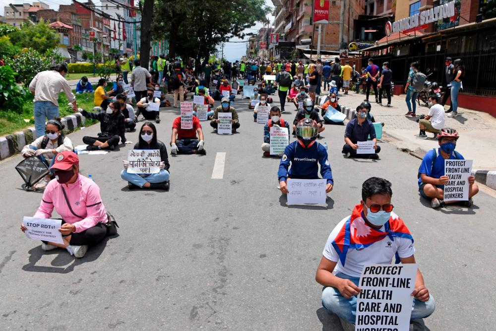Protesters maintain a distance from each other in Kathmandu on Saturday.