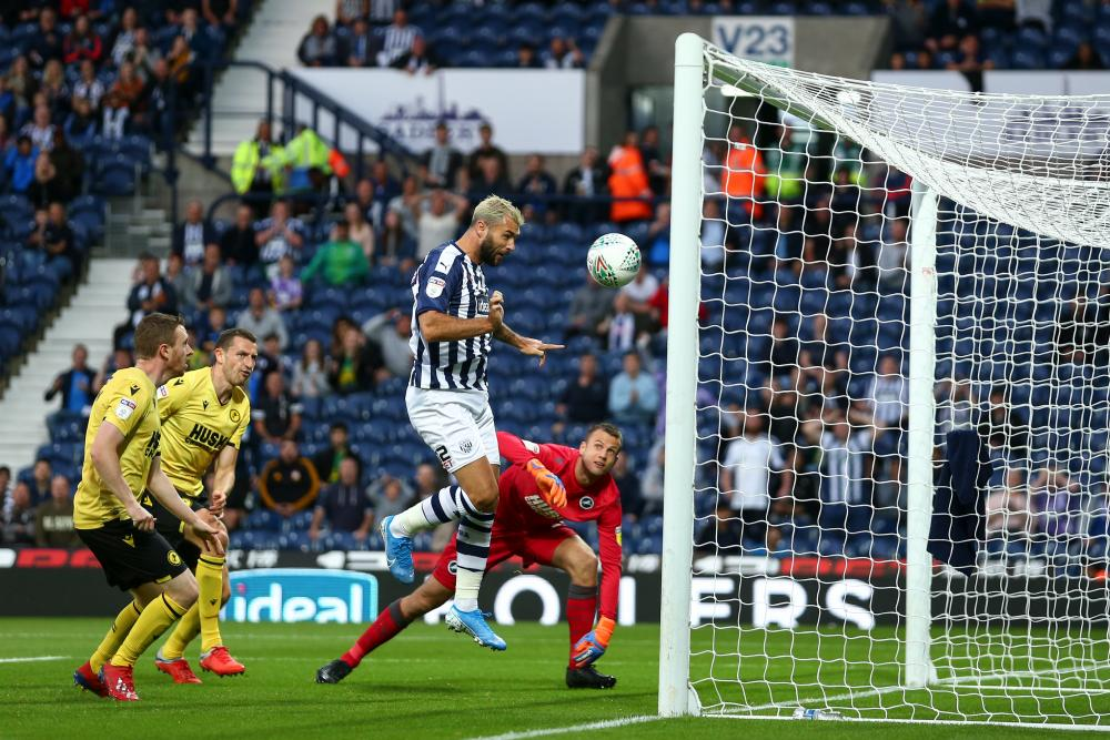 Charlie Austin heads home the opener at The Hawthorns.