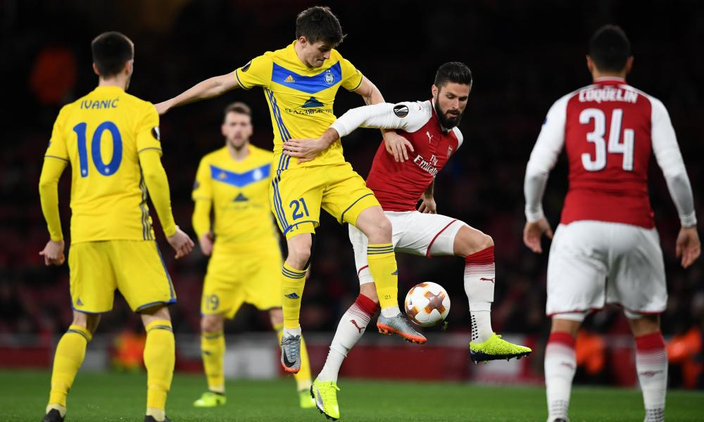 An early tussle between Arsenal's Olivier Giroudand BATE Borisov's Stanislav Dragun.