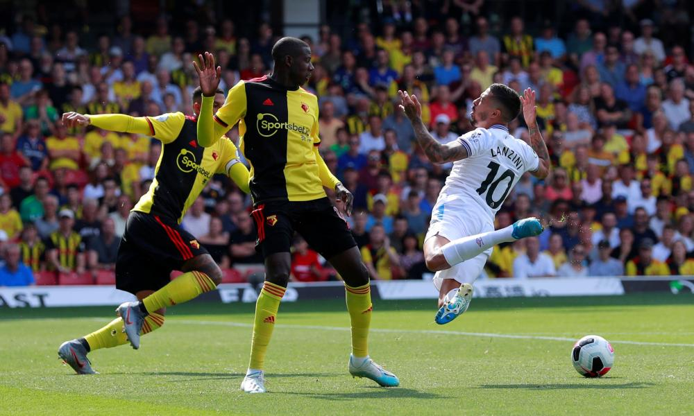 Watford's Abdoulaye Doucoure fouls West Ham United's Manuel Lanzini in the box.