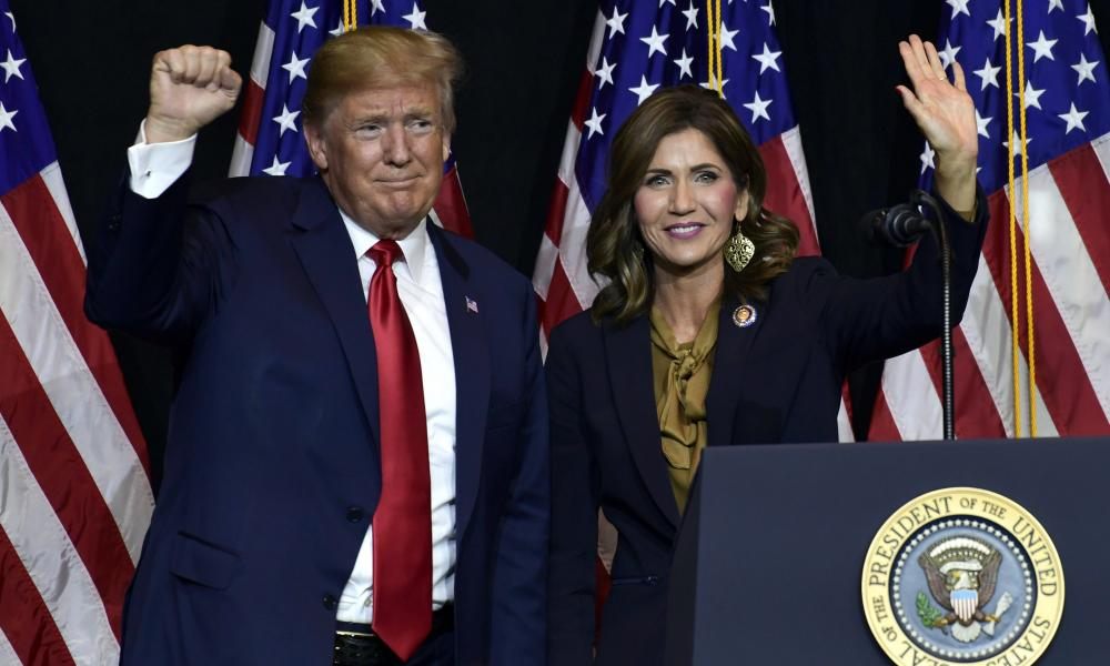 Donald Trump and Kristi Noem in August.