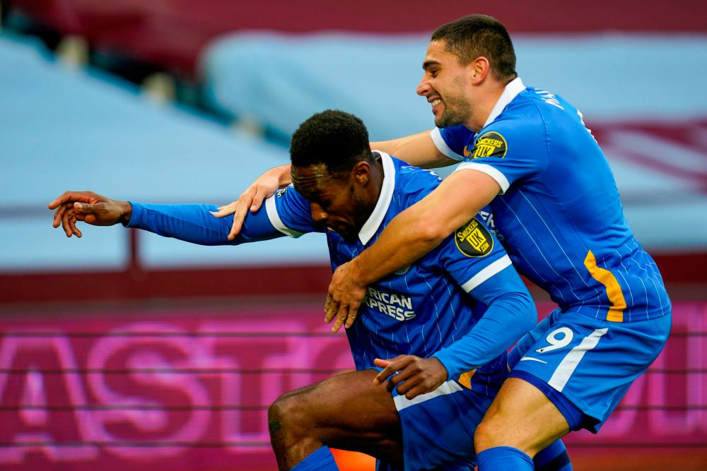 Danny Welbeck celebrates his Villa Park goal with Neal Maupay.