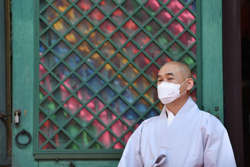 A Buddhist monk prepares to celebrate Buddha's birthday at Jogye temple in Seoul.