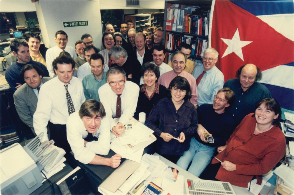 Boseley (centre) in the Guardian's Farringdon Road office, in the mid-1990s