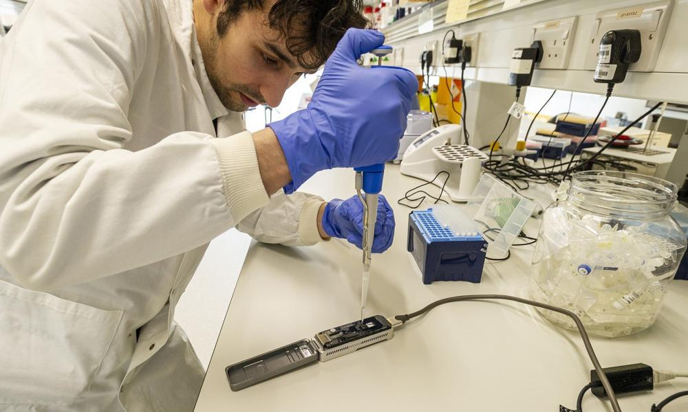 A technician at Oxford Nanopore sequences genes in the laboratory