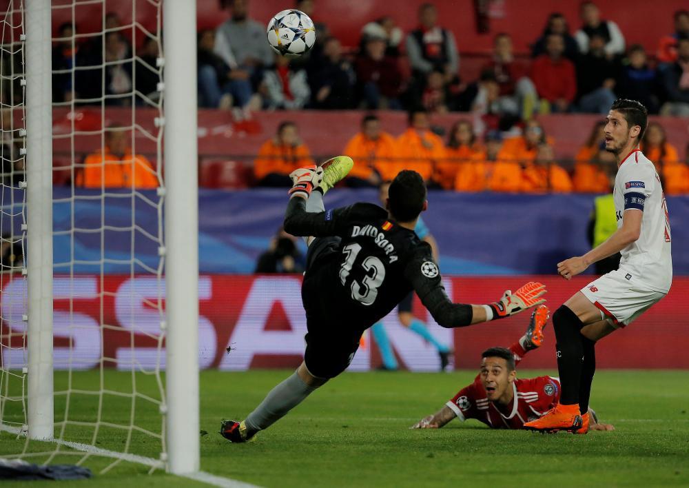 Thiago Alcantara's header is deflected past Soria by Escudero.