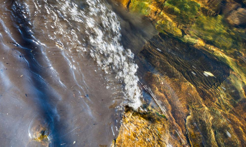 Raw sewage mixing with clean clear water in the river Kent in Kendal, Cumbria, UK.