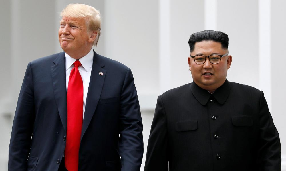 """Trump and Kim walk out of the Capella hotel after their working lunch. On this walk Trump told reporters that the two men would proceed to a """"signing"""", although it is still unclear what is being signed."""