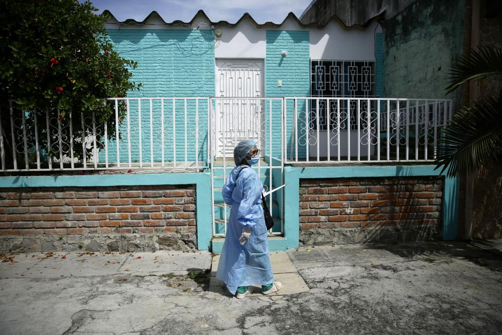 Medics visit residents during a health day in the municipality of Soyapango, El Salvador, on Wednesday.