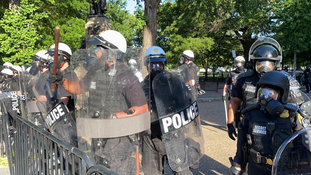 Riot police form a cordon near the White House