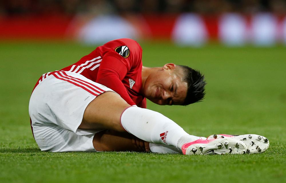 Marcos Rojo sustains an injury and is taken off.