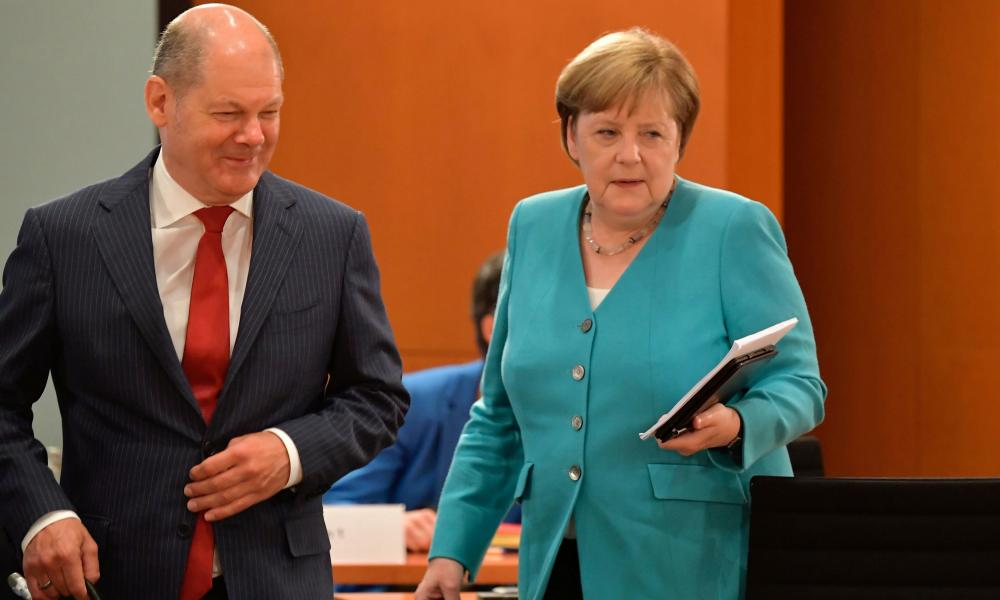 Germany chancellor Angela Merkel and finance minister Olaf Scholz arrive for the weekly cabinet meeting at the Chancellery in Berlin, Germany June 17, 2020