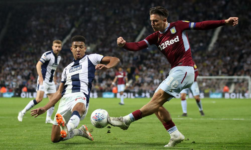 West Bromwich Albion's Mason Holgate attempts to block a cross by Aston Villa's Jack Grealish.