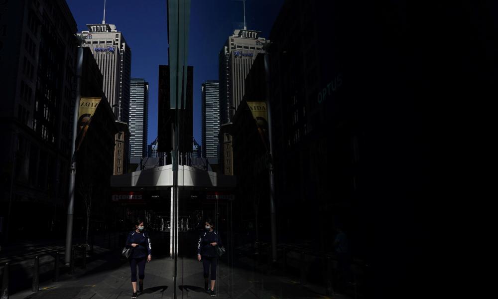 A pedestrian walks through the city centre during Sydney's Covid lockdown
