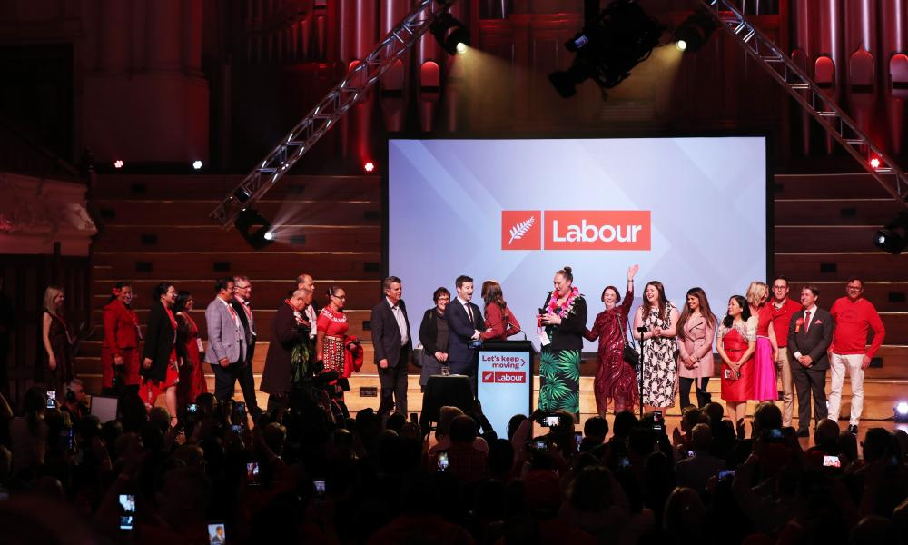 New Zealand Prime Minister Jacinda Ardern (C), her hushand Clarke Gayford (centre L) and party members gather on the stage at the Labour Party's after party following victory in the the country's general election in Auckland on 17 October 2020.