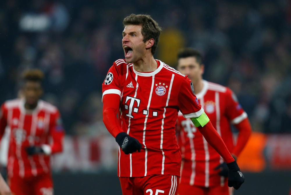 Muller celebrates his second of the night.