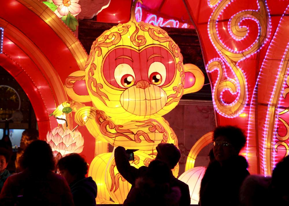 A visitor takes pictures of a Monkey lantern at a festival ahead of the upcoming Spring Festival in Nanjing, Jiangsu province, February 4, 2016. Picture taken February 4, 2016. REUTERS/Stringer ATTENTION EDITORS - THIS PICTURE WAS PROVIDED BY A THIRD PARTY. THIS PICTURE IS DISTRIBUTED EXACTLY AS RECEIVED BY REUTERS, AS A SERVICE TO CLIENTS. CHINA OUT. NO COMMERCIAL OR EDITORIAL SALES IN CHINA.