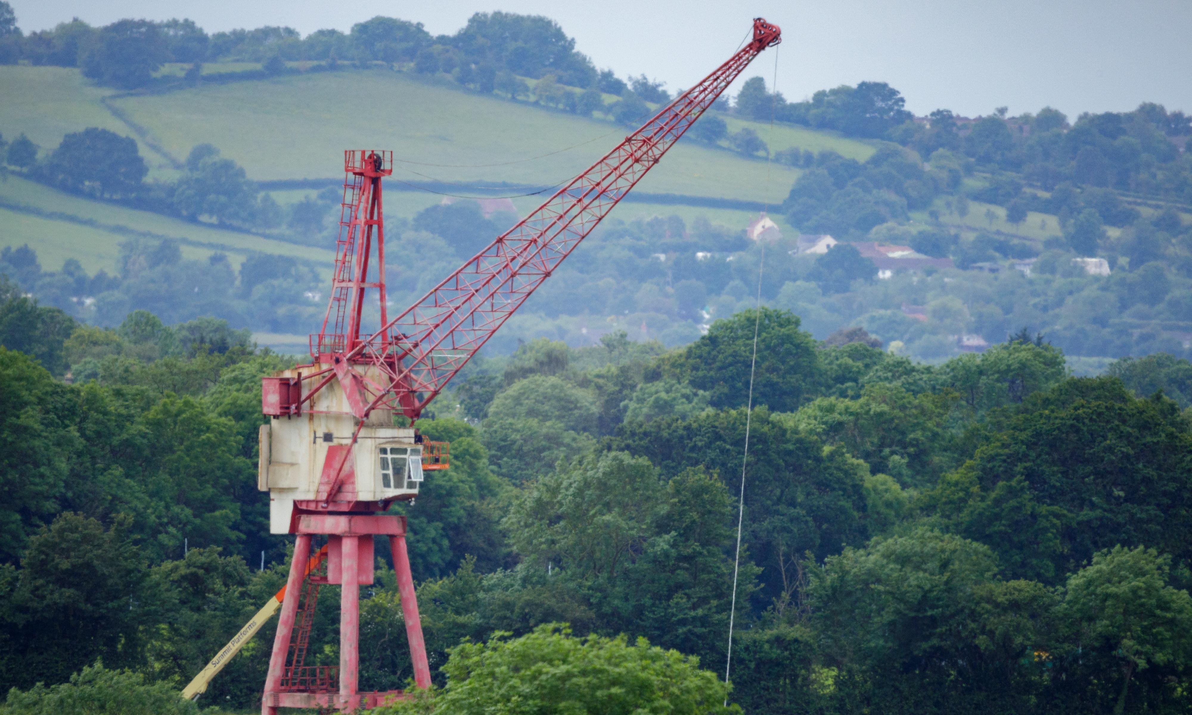 The 140-tonne, fire-breathing crane: inside Glastonbury's hottest attraction