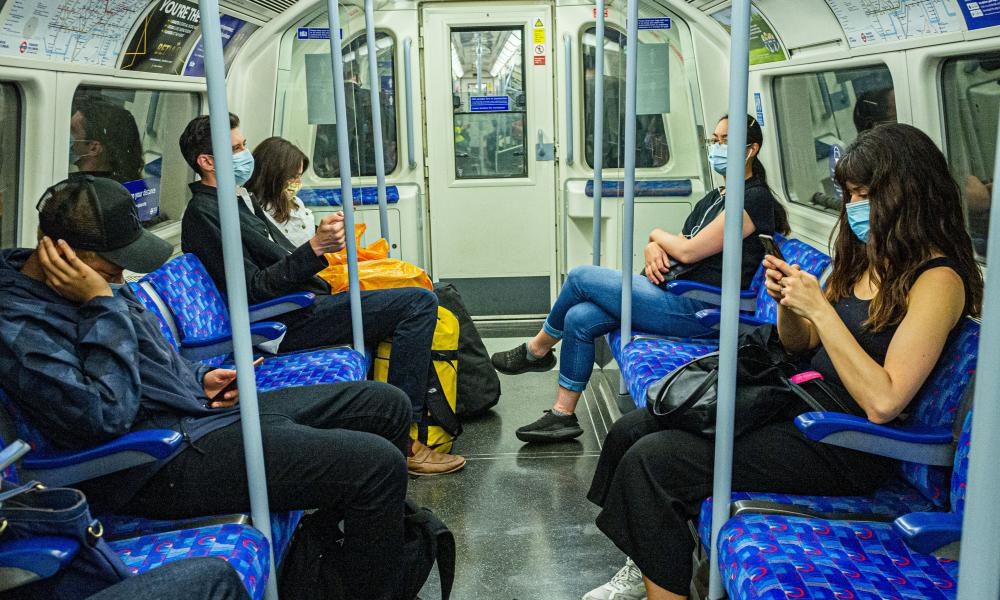 Masked passengers on the London Underground in England.