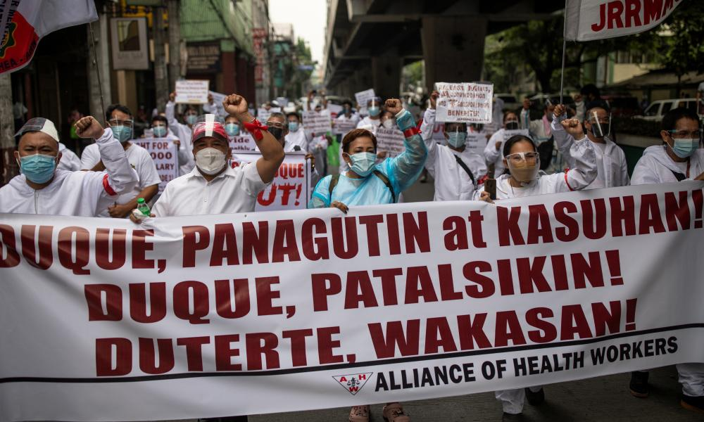 Healthcare workers protest outside the Department of Health in Manilla.