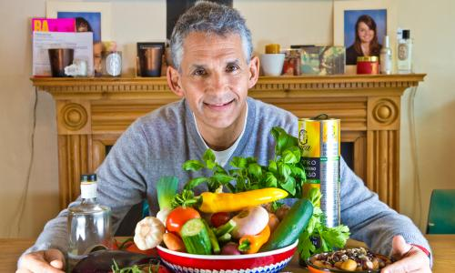 Professor Tim Spector at home with vegetables.