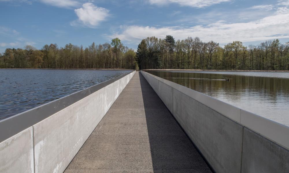 Cycling through water in Limburg.