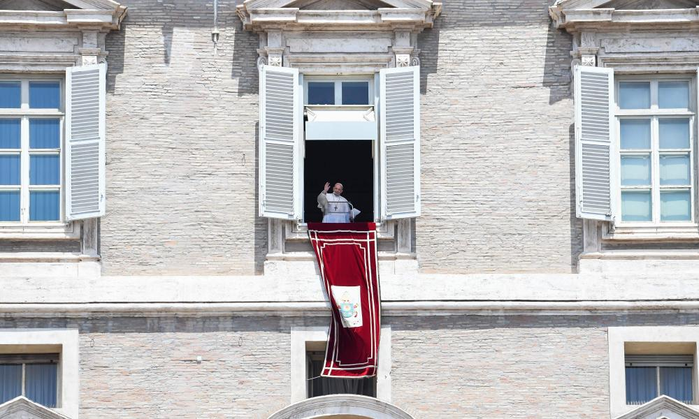 Pope Francis waves to the crowd from the window of the apostolic palace overlooking St Peter's square during the Sunday Angelus prayer, on June 7, 2020, in the Vatican. (Photo by Andreas SOLARO / AFP)