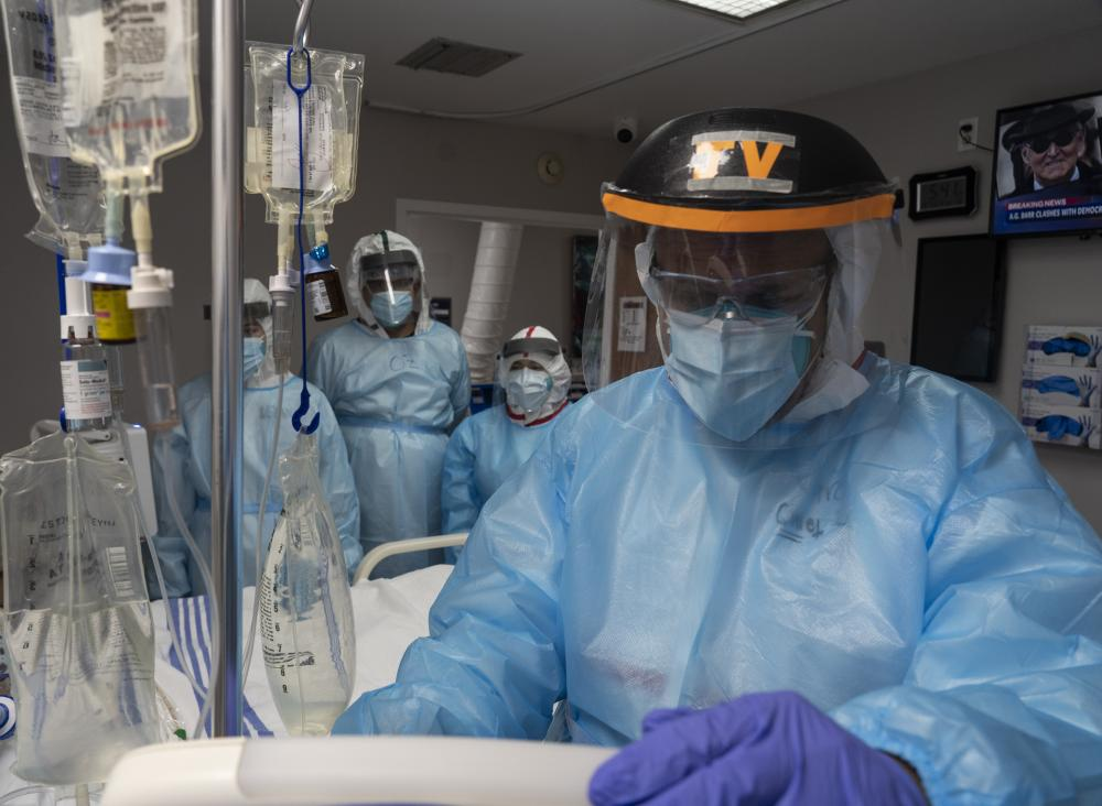 Medical staff treat a patient in the Covid-19 intensive care unit at the United Memorial Medical Center in Houston, Texas. Covid-19 cases and hospitalisations have surged since Texas reopened, pushing intensive-care units to full capacity and sparking concerns about a surge in fatalities as the virus spreads.