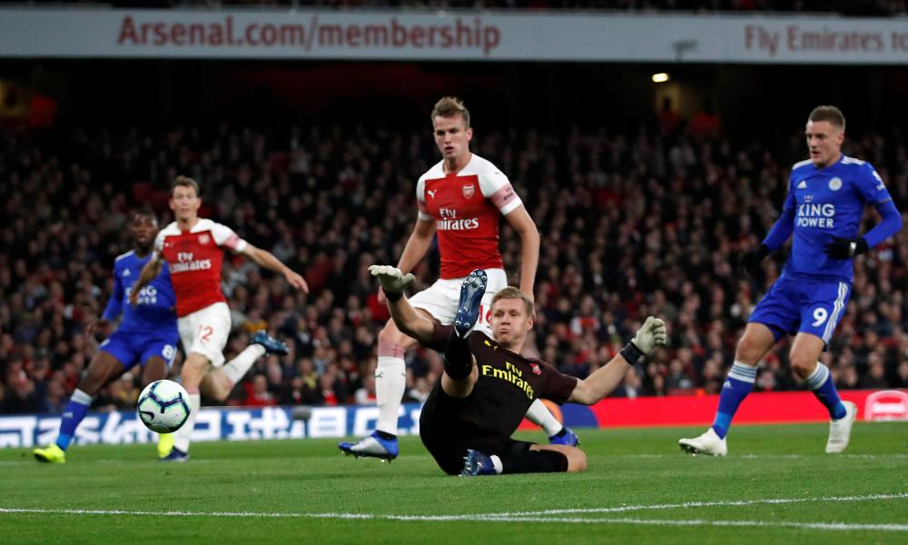 Goalkeeper Bernd Leno is wrong-footed by the deflection.