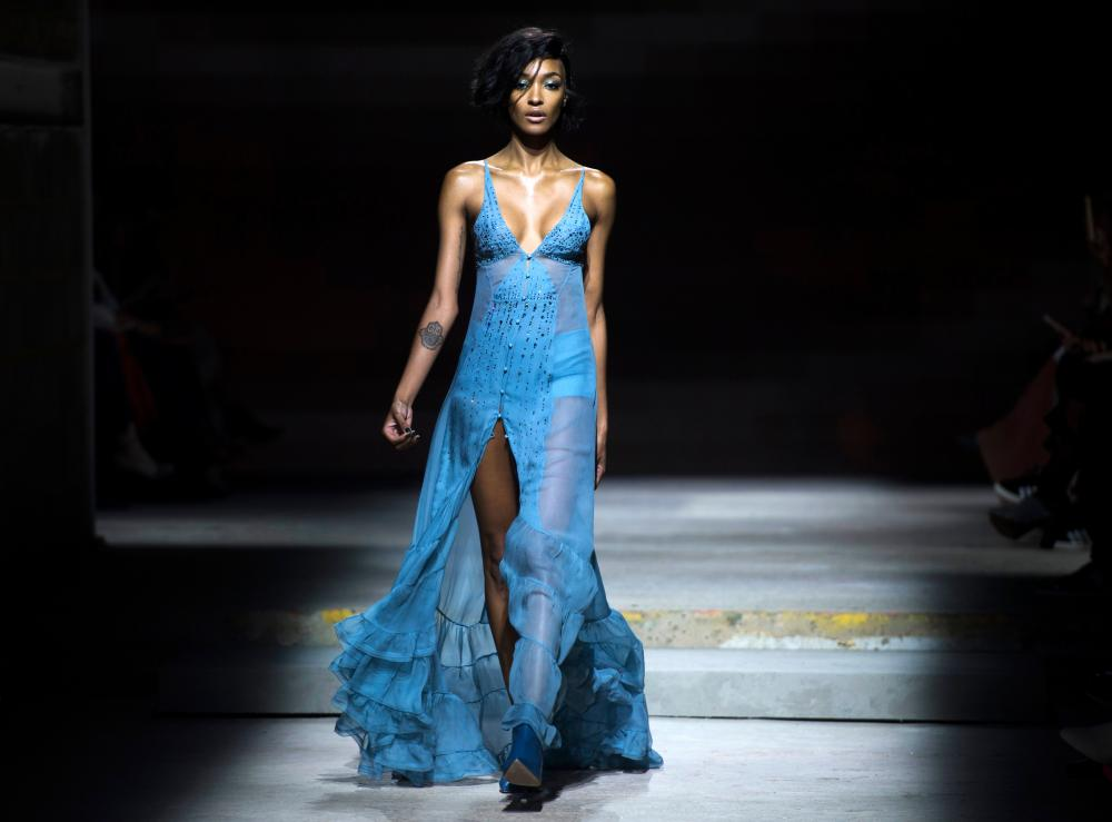 British model Jourdan Dunn presents a creation by Topshop