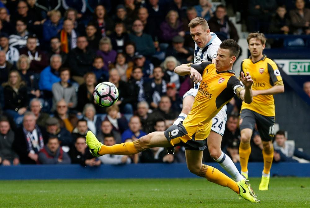 West Bromwich Albion's Darren Fletcher unleashes a piledriver past Arsenal's Laurent Koscielny but a diving Petr Cech beats it away.