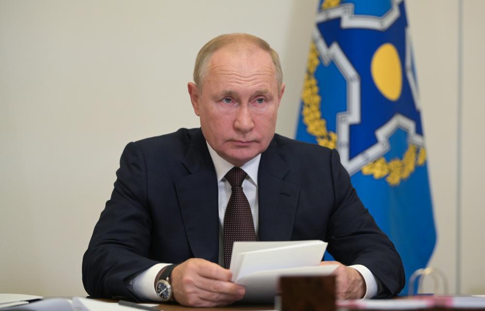 Vladimir Putin in his office in the Novo-Ogaryovo residence.