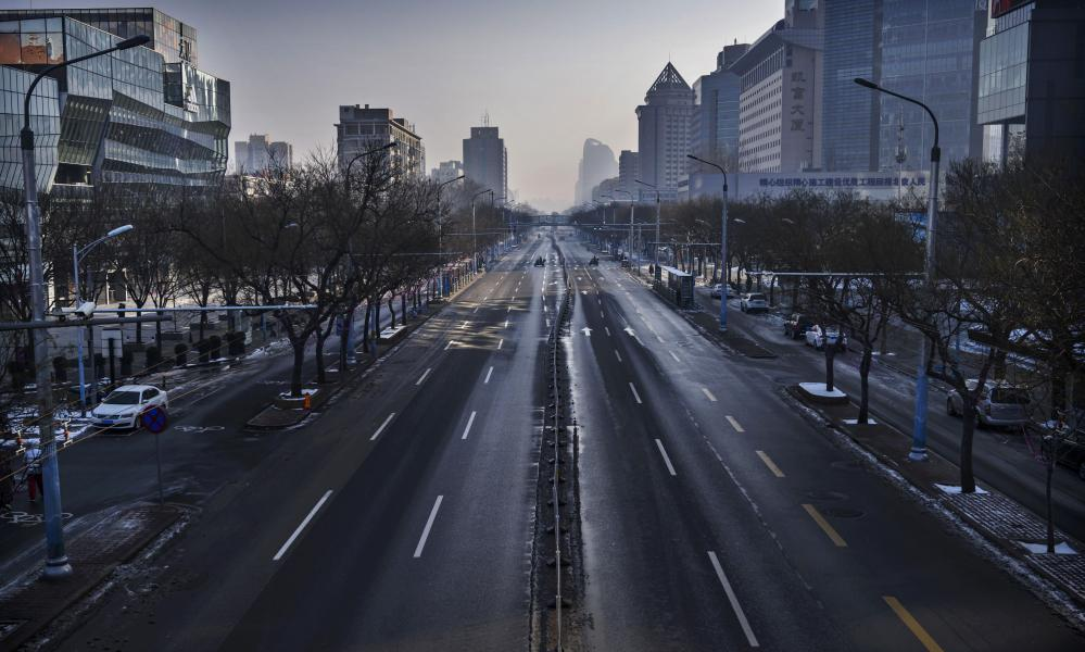 A nearly empty street is seen in a usually busy shopping district in Beijing