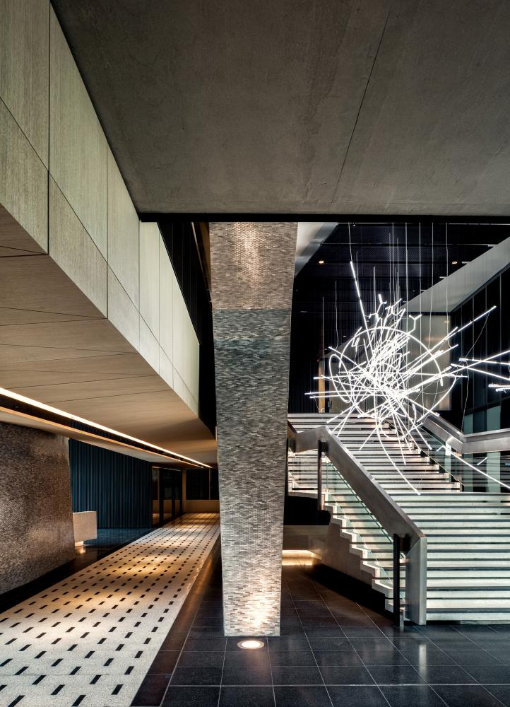 Centre Point's lobby area, featuring a Cerith Wyn Evans light installation.