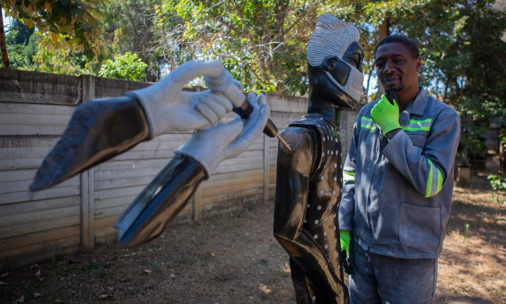 """David Ngwerume shows his artwork called """"Arms"""" in Harare, Zimbabwe. David Ngwerume is making Sculptures which is disseminating COVID-19 messages through his artwork. He has carved a sculptor called Arms which has become his signature piece during the pandemic."""