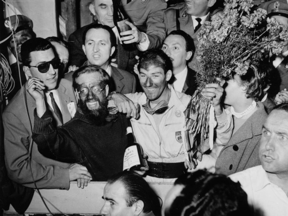 Stirling Moss, and his partner Denis Jenkinson, celebrate after winning the 1955 Mille Miglia