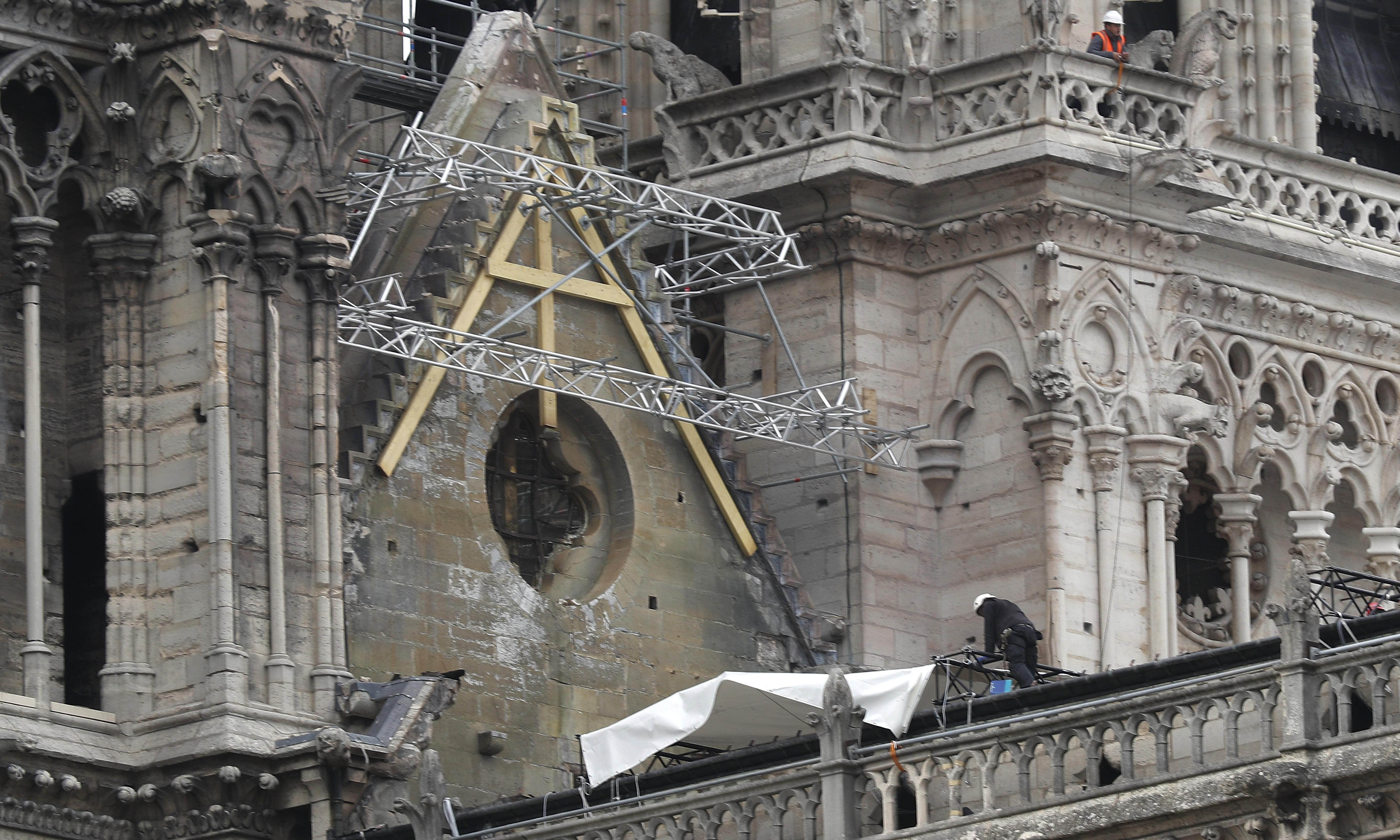 Climbers brought in to help protect Notre Dame from elements
